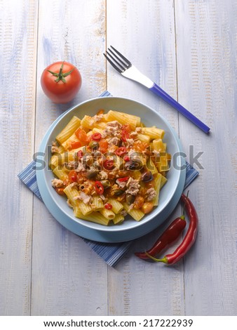 pasta with tuna tomatoes hot chili pepper and olives - stock photo