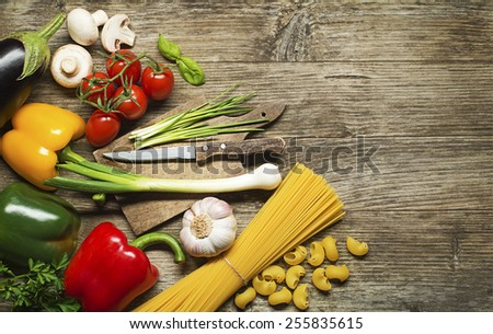 Pasta with Vegetables ingredients on old wooden table - stock photo