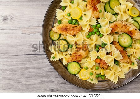 Pasta with zucchini and chicken - stock photo