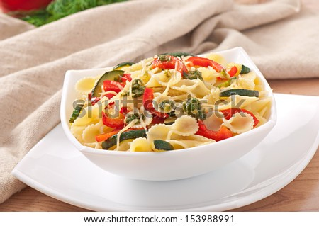 pasta with zucchini and sweet peppers with basil-garlic dressing - stock photo