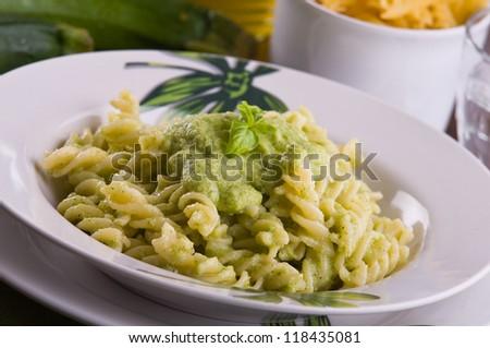 Pasta with zucchini pesto. - stock photo