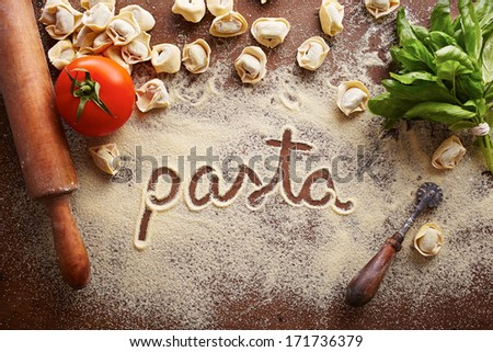 Pasta word written on table composition with ingredients - stock photo