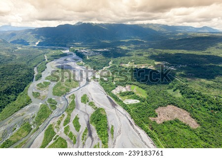 PASTAZA RIVER EXITING ANDES MOUNTAIN, ECUADOR, HIGH ALTITUDE FULL SIZE HELICOPTER  - stock photo
