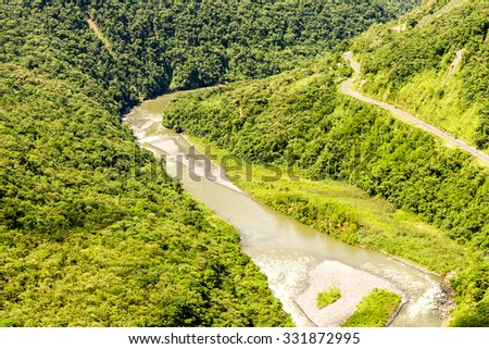Pastaza River Valley In Ecuadorian Andes And Pan American Road High Altitude Full Size Helicopter Shot - stock photo