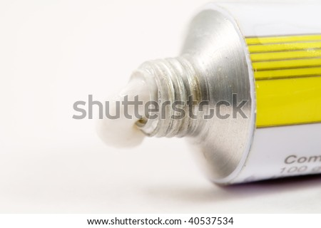 Paste (medicine) squeezed out of the tube isolated on white - stock photo