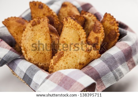 Pastel, a Brazilian snack, in a white background. - stock photo