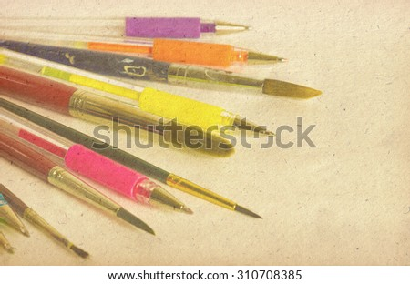 Pastel background on the old paper  with set of multicolor pens - stock photo