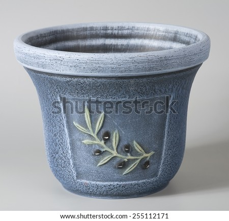 Pastel blue rustic ceramic flowerpot with stylized decorative floral ornaments - stock photo