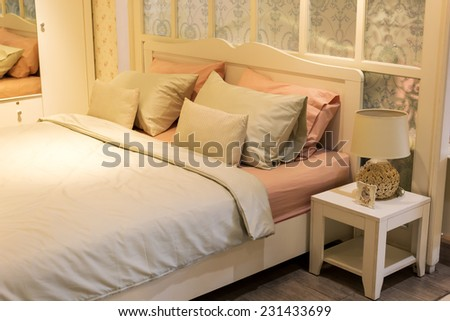 pastel color bed, bedroom - stock photo