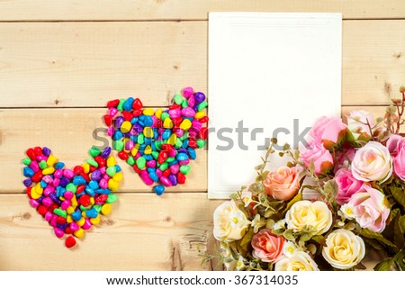 Pastel color roses flowers and empty tag for your text with  on wooden background - stock photo