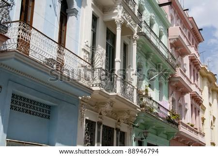 Pastel colored balconies in Havana backstreet - stock photo