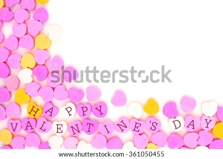 Pastel colored candy hearts with Happy Valentines Day text forming a corner border over white - stock photo