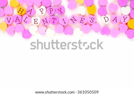 Pastel colored candy hearts with Happy Valentines Day text forming a top border over white - stock photo