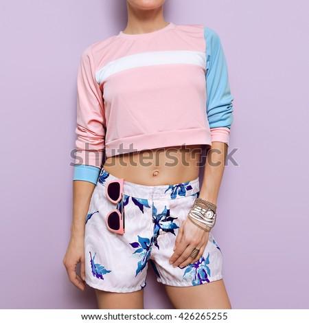 Pastel colored clothing. Summer trend. Stylish fashion Girl. - stock photo