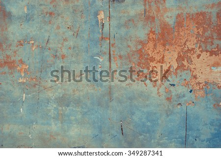 Pastel colored peeled concrete surface. Vintage effect. - stock photo
