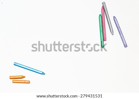 Pastel colored pencils on a blank sheet of paper. Space for text. The concept of drawing and design. - stock photo