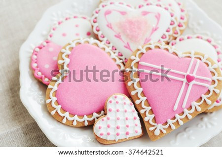 Pastel colored sugar cookies for valentines day on white plate