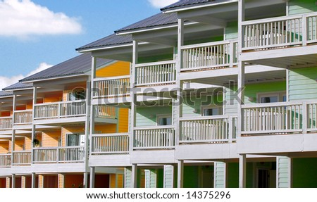 Pastel colored tropical townhomes - stock photo