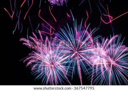 Pastel Fireworks.  Fireworks finale with blue red and pink colors. - stock photo
