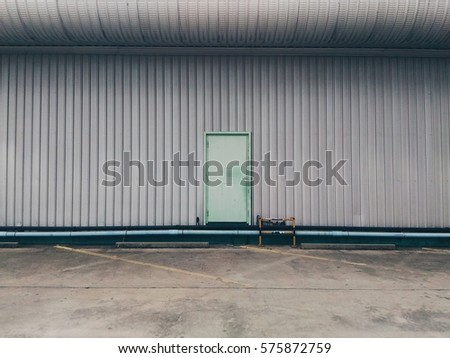 Pastel green factory door.