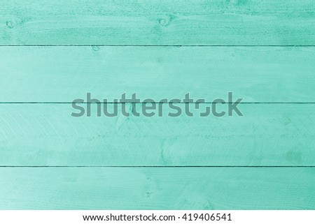 Pastel green stained wood background texture with horizontal parallel boards, woodgrain and copy space, full frame - stock photo