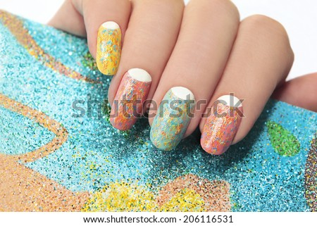 Pastel manicure with different colors of paint and coating in the form of colored stripes. - stock photo