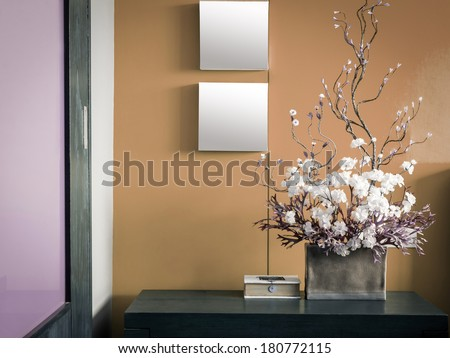 Pastel modern interior wall decorate with artificial flowers in ceramic vase - stock photo
