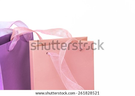 Pastel pink and lilac colorful shopping bags tops closeup isolated - stock photo