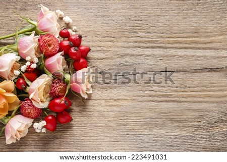 Pastel pink roses and chrysanthemums on wooden background. Copy space - stock photo