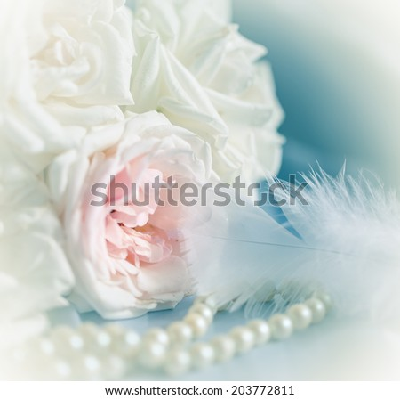 Pastel roses,pearl and feather  to wedding with pastel filter - stock photo