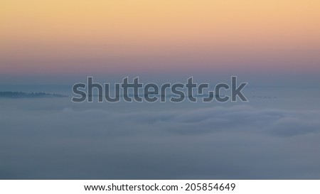 Pastel sky over the sea of mist - stock photo