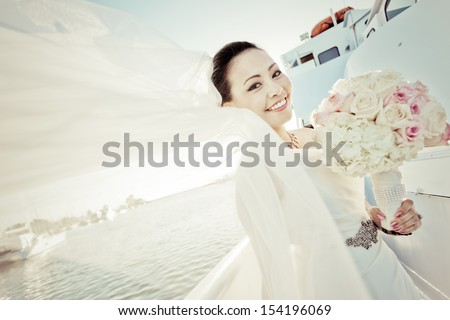 Pastel tone of young asian bride having her wedding party on small cruise - stock photo