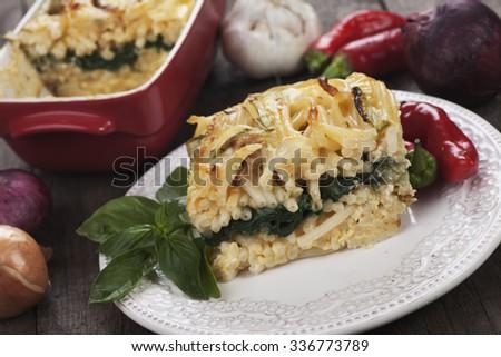 Pasticcio or pastitsio, oven baked pasta with zucchini and chard - stock photo