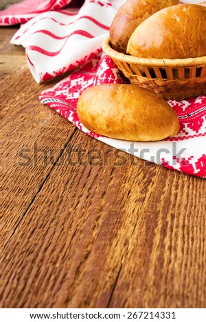 Pasties stuffed meat on a dark wood background, selective focus - stock photo