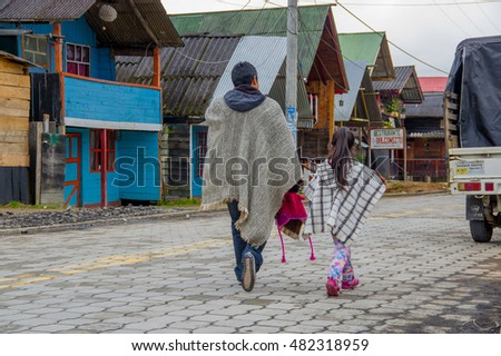 PASTO, COLOMBIA - JULY 3, 2016: native people with traditional clothes walking in the street in la cocha lake