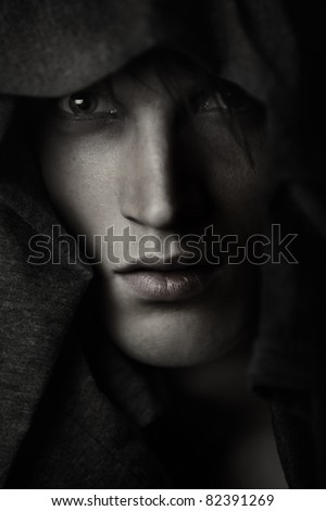 Pastor in the Catholic robe. Artistic colors and grain added for moody effect - stock photo