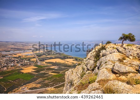 Pastoral nature landscape of Arbel Cliff National park and Agriculture valley Magic view of Galilee Sea (Tiberius lake or Kineret) in the distance background. Seasons and travel. Low Galilee. Israel