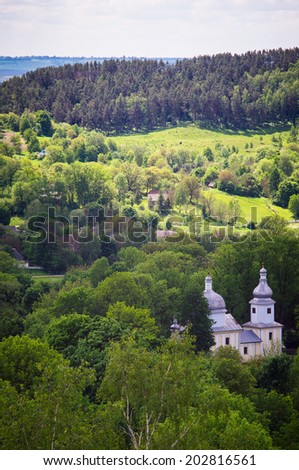 Pastoral view of the mountain village with a church