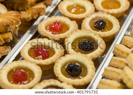pastries decorated with cherries and jam - stock photo