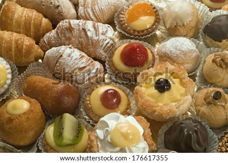 pastries, small italian dessert, patisserie mignon  - stock photo
