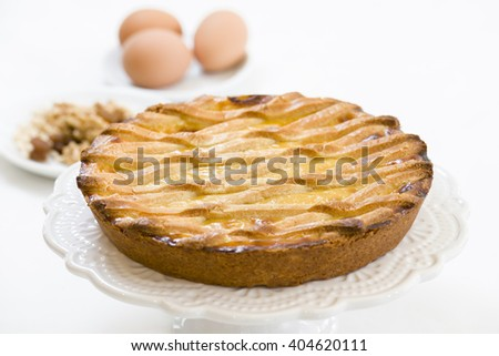 pastry cake with cream and filled with walnuts - stock photo