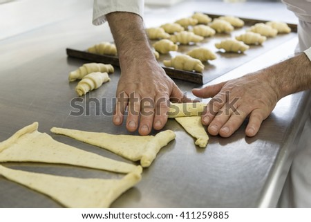 pastry chef shapes the dough with your hands for cookies - stock photo