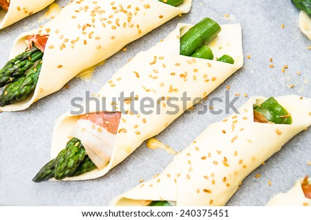pastry filled with asparagus and prosciutto - stock photo