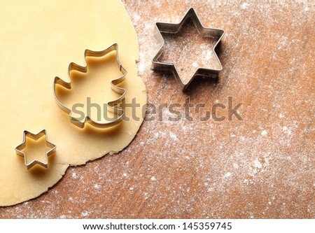 Pastry for Christmas cookies and cookie cutters.