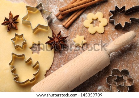 Pastry for Christmas cookies, spices and cookie cutters.