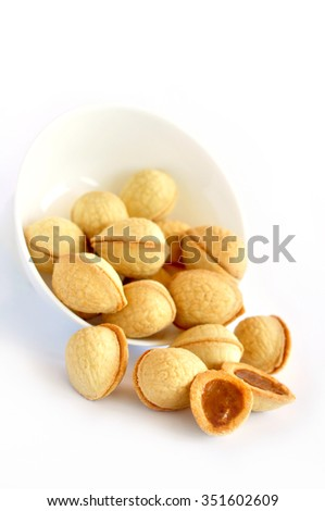 Pastry nuts filled with condensed milk - stock photo