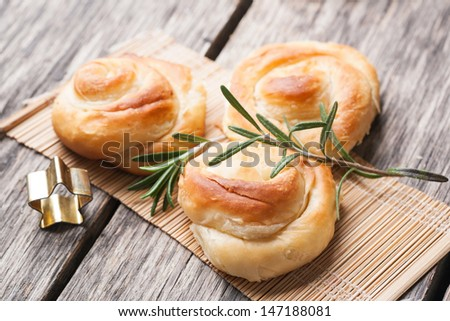 Pastry with cheese and rosemary - stock photo