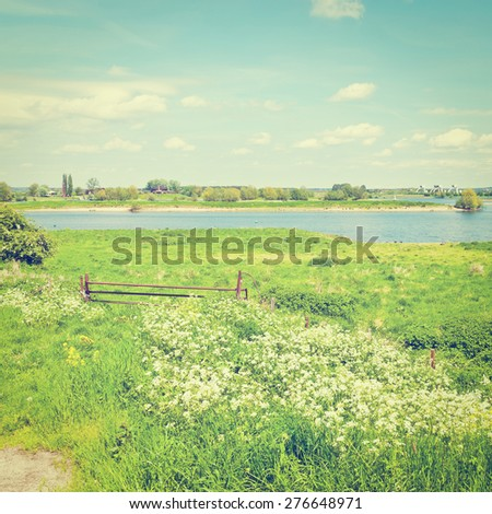 Pasture on the Banks of the Rhine in Holland, Instagram Effect - stock photo