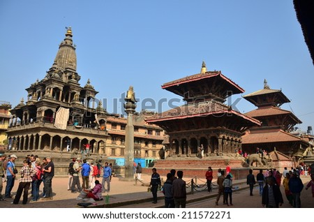 PATAN, NEPAL - NOVEMBER 2 : Traveler and Nepalese people come to Patan Durbar Square for travel and pray on November 2, 2013 in Patan Nepal. - stock photo