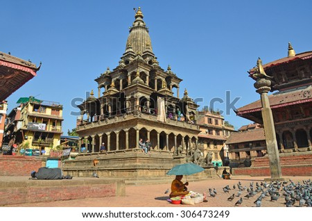 Patan, Nepal, October, 26, 2012, Nepali  Scene: Tourists walking on ancient Durbar square.  In may 2015 square partially destroyed during the earthquake